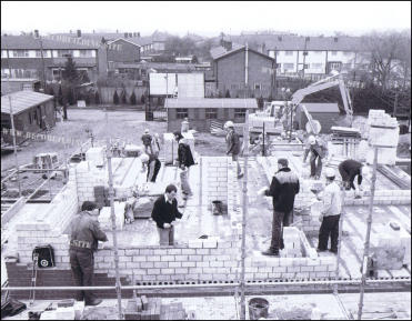 Dennis, Oz and Bomber along with their German co-workers during the opening scenes of Series 1, Episode 1 at Elstree Studio backlot doubling at the German BECO Building Site.